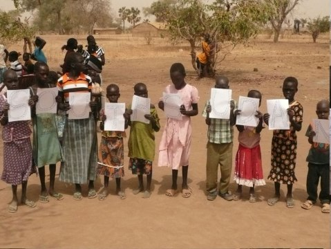 Children holding the South Sudan sign
